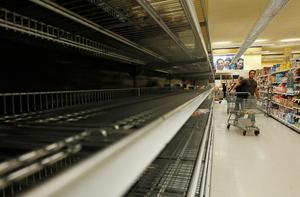 LONG BEACH, NY - OCTOBER 28:  Only a few bread items remain on the shelves at the Waldbaums grocery store as Hurricane Sandy approaches on October 28, 2012 in Long Beach, New York. Sandy, which has already claimed over 50 lives in the Caribbean is predicted to bring heavy winds and floodwaters to the mid-atlantic region.  (Photo by Mike Stobe/Getty Images)