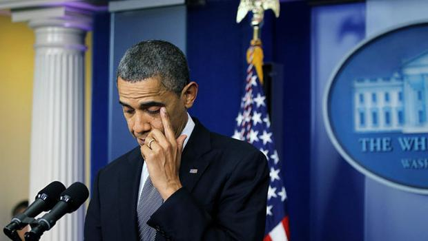 WASHINGTON, DC - DECEMBER 14:  U.S. President Barack Obama wipes tears as he makes a statement in response to the elementary school shooting in Connecticut December 14, 2012 at the White House in Washington, DC. According to reports, there are about 27 dead, perhaps 17 of them children, after Ryan Lanza, 24, opened fire in at the Sandy Hook Elementary School in Newtown, Connecticut. Reports say that Lanza is dead at the scene and his mother, a teacher at the school, is also dead.  (Photo by Alex Wong/Getty Images)