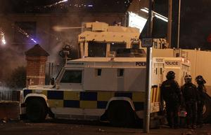 PSNI officers and loyalists clash in the Village area of south Belfast near the Broadway roundabout