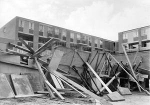 Riots : Belfast. August 1969.  The road into Unity Walk flats is blocked with a massive fortress of garage doors ripped off from the new parking area, flagstones and planks of wood.  (4/8/69)