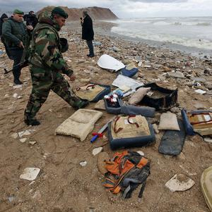 Lebanese soldiers gather debris from an Ethiopian Airlines plane that crashed in the sea (AP)