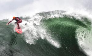 Alastair Mennie catching a 30 foot wave off the Donegal coast