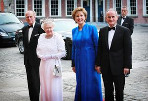 Britain's Queen Elizabeth II and the Duke of Edinburgh pictured with Irish President Mary McAleese and her husband Dr Martin McAleese  at Dublin Castle