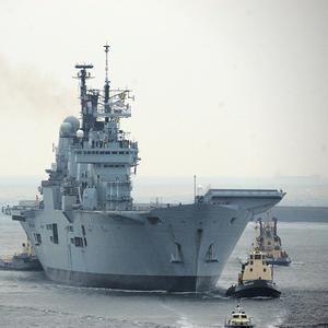 A group of former Royal Navy chiefs has condemned the decision to axe the Ark Royal aircraft carrier