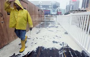 ATLANTIC CITY, NJ - OCTOBER 29:  A worker walks past sea foam partially covering the deck of a structure ahead of Hurricane Sandy on October 29, 2012 in Atlantic City, New Jersey. Governor Chris ChristieÄôs emergency declaration is shutting down the cityÄôs casinos and 30,000 residents were ordered to evacuate. (Photo by Mario Tama/Getty Images)