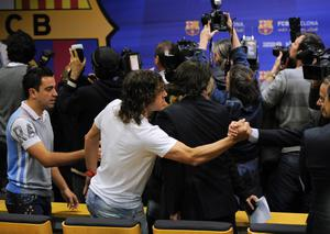 BARCELONA, SPAIN - APRIL 27: Xavi Hernandez (L) and Carles Puyol of FC Barcelona arrive to the press conference of Head coach Josep Guardiola of FC Barcelona at the Camp Nou stadium on April 27, 2012 in Barcelona, Spain. Josep Guardiola has today announced he is not renewing his contract after a 4 year tenure as Head Coach of the FC Barcelona squad.  (Photo by David Ramos/Getty Images)