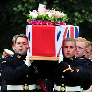 Pall bearers from the Royal Marines carry the coffin of their colleague, Lance Corporal Martin Gill, 22