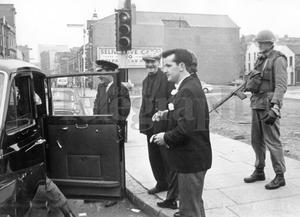 Riots : Belfast. August 1969.  A wedding taxi is searched at Divis Street.  The bridegroom, Mr. P. Gribbon, who was on his way to the wedding in St. Peter's Pro. Cathedral in the sealed-off area.  (16/8/69)