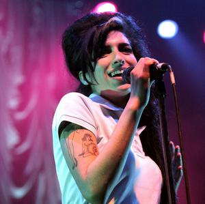Amy Winehouse could have seven songs in the singles chart this weekend