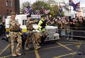 The British Army's Royal Irish Regiment parades through Belfast city under tight security from riot police, in Belfast, Northern Ireland, Sunday, Nov. 2, 2008. Riot police kept apart rival loyalist and Republican supporters at a parade to honor Northern Ireland members of British armed forces that have recently returned from war zones in Iraq and Afghanistan.  (AP Photo/Peter Morrison)