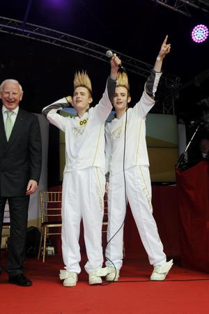 John (left) and Edward Grimes aka Jedward making a speech on stage after the lighting of the cauldron at St Stephen's Green in Dublin