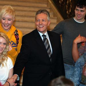 First Minister Peter Robinson meets guests on his way into the Assembly chamber at Stormont, prior to discussing the budget