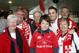 Ulster fans wait on their train at Belfast Central train station as more than 2% of the population of Northern Ireland will be in Dublin this weekend to watch Ulster play in rugby's Heineken Cup semi-final