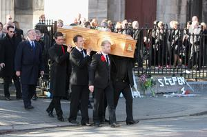 Ronan Keating, Mikey Graham and Shane Lynch carry out the coffin after the funeral of Boyzone singer Stephen Gately at St Laurence O'Toole Church in Dublin