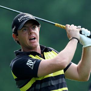 Rory McIlroy, pictured, says he has never been intimidated by Tiger Woods