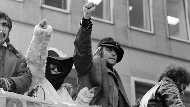John Lennon and his wife Yoko Ono raise their fists as they join a protest in front of British Overseas Airways Corp. offices in New York on Fifth Avenue, Feb 5th 1972. The demonstrators called for the withdrawal of British troops from Northern Ireland.