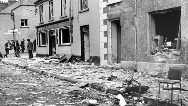 Main Street Claudy in August 1972 when three Provisional IRA car bombs exploded without warning, killing 9 local people and injuring many others.
