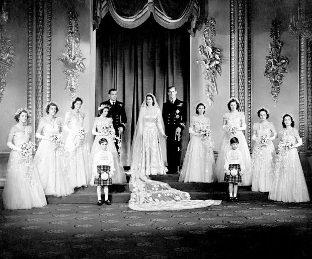 File photo dated 20/11/1947 Princess Elizabeth, now Queen, and Lieutenant Philip Mountbatten, now the Duke of Edinburgh with their eight bridesmaids in the Throne Room at Buckingham Palace, on their wedding day. PRESS ASSOCIATION Photo.