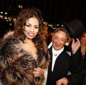 Karima el-Mahroug arrives with her host Richard Lugner at the traditional Opera Ball (AP)