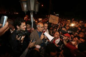 CAIRO, EGYPT - JANUARY 30:  Opposition leader Mohamed ElBaradei speaks to supporters in Tahrir Square on January 30, 2011 in Cairo, Egypt. Cairo remained in a state of flux and marchers continued to protest in the streets and defy curfew, demanding the resignation of Egyptian president Hosni Mubarek. As President Mubarak struggles to regain control after five days of protests he has appointed Omar Suleiman as vice-president. The present death toll stands at 100 and up to 2,000 people are thought to have been injured during the clashes which started last Tuesday. Overnight it was reported that thousands of inmates from the Wadi Naturn prison had escaped and that Egyptians were forming vigilante groups in order to protect their homes.   (Photo by Peter Macdiarmid/Getty Images) *** BESTPIX ***