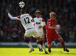 LIVERPOOL, UNITED KINGDOM - MARCH 06:  Dirk Kuyt of Liverpool competes with Chris Smalling of Manchester United during the Barclays Premier League match between Liverpool and Manchester United at Anfield on March 6, 2011 in Liverpool, England. (Photo by Alex Livesey/Getty Images)