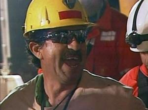 In this screen grab taken from video, Juan Andres Illanes, the third miner to be rescued, celebrates after his rescue Wednesday, Oct. 13, 2010 at San Jose Mine near Copiapo, Chile. (AP Photo)