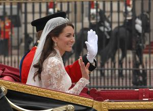 Prince William and his bride Kate make their way down The Mall in London in the procession to Buckingham Palace after the wedding ceremony. PRESS ASSOCIATION Photo. Picture date: Friday April 29, 2011. Photo credit should read: Chris Ison/PA Wire