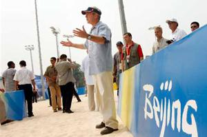President Bush cheers on Misty May Treanor and Kerri Walsh as he visits the practice of the U.S. beach volleyball team at the 2008 Summer Olympic games in Beijing, China Saturday, Aug. 9, 2008.
