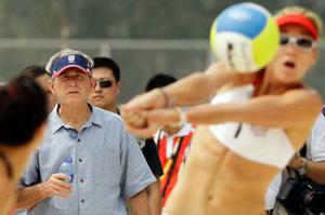 U.S. President George Bush watches as U.S. team of Misty May Treanor, left, and Kerri Walsh warm up at the Chaoyang Park Beach Volleyball Ground at the Beijing 2008 Olympics in Beijing, Saturday, Aug. 9, 2008.