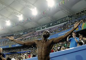 Usain Bolt throws his arms into the air after a false start led to his disqualification from the 100m final at the World Championships in Daegu