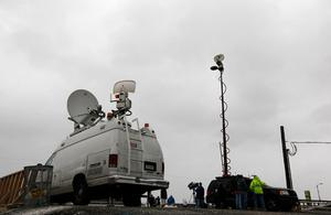 LONG BEACH, NY - OCTOBER 28: TV crews set up along the Long Beach boardwalk as Hurricane Sandy approaches on October 28, 2012 in Long Beach, New York. Sandy,which has already claimed over 50 lives in the Caribbean is predicted to bring heavy winds and floodwaters to the mid-atlantic region.  (Photo by Mike Stobe/Getty Images)
