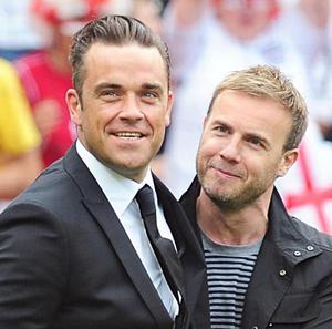 Robbie Williams (left) and Gary Barlow are to release a duet in October