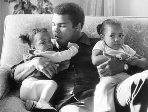 1978: Heavyweight boxer Muhammad Ali with his daughters Laila (9 months) and Hanna (2 years 5 months) at Grosvenor House on December 17, 1978.
