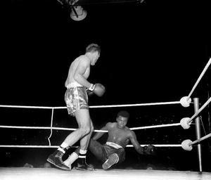 18/6/1963: Henry Cooper knocks down Cassius Clay during the fourth round.