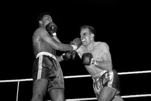 18/6/1963: Cassius Clay and Henry Cooper during their fight at Wembley, London.