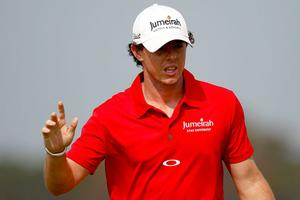 KIAWAH ISLAND, SC - AUGUST 12:  Rory McIlroy of Northern Ireland waves after hitting out of the sand on the tenth hole during the Final Round of the 94th PGA Championship at the Ocean Course on August 12, 2012 in Kiawah Island, South Carolina.  (Photo by Jonathan Ferrey/Getty Images)