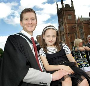 Queen's University Belfast Graduations. Paul Hardy who graduated in Social Work with his 7 year old daughter Alex Hardy