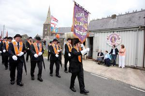 Press Eye - Belfast - Northern Ireland - 10th July 2011 - Picture by Jonathan Porter/ PressEye.com -  Annual Drumcree Orange Order parade in Portadown.  The parade is stopped outside Drumcree Church from going down the mainly nationalist Garvaghy Road.  The parade makes its way to the barrier.