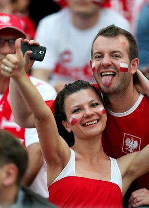 WARSAW, POLAND - JUNE 08:  Polish fans soak up the atmopshere during the UEFA EURO 2012 Group A match between Poland and Greece at National Stadium on June 8, 2012 in Warsaw, Poland.  (Photo by Alex Grimm/Getty Images)