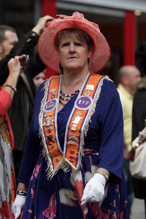 An Orange woman pictured on Royal Avenue as the parade makes its way through Belfast City Centre