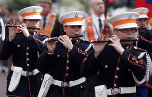 Glasgow Orange Defenders Flute Band makes it way through Belfast