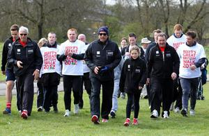 Cricket legend  Sir Ian Botham (centre) and Celtic manager Neil Lennon (4th left) join walkers in Drumpellier Country Park, Coatbridge, during the first leg of Sir Ian's 14th charity walk, in support of Leukaemia & Lymphoma Research