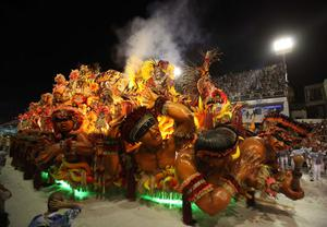 Members of Beija Flor  samba school perform on a float during carnival celebrations at the Sambadrome in Rio de Janeiro, early Monday, Feb.15, 2010. (AP Photo/Martin Mejia)