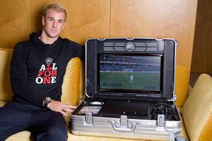 f England goalkeeper Joe Hart has revealed he will play computer games to fill the time between matches at Euro 2012 as EA Sports has presented him with a state of the art mobile gaming case