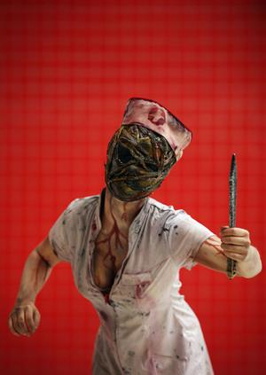 LONDON, ENGLAND - OCTOBER 26:  Jess Duzniak, 18, from Essex poses as a nurse from the comic book series Silent Hill ahead of the MCM London Comic Con Expo at ExCel on October 26, 2012 in London, England. Visitors to the Comic Convention are encouraged to wear a costume of their favourite comic character and flock to the Expo to gather all the latest news in the world of comics, manga, anime, film, cosplay, games and cult fiction.  (Photo by Dan Kitwood/Getty Images)