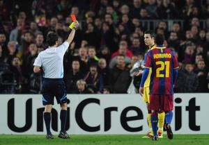 BARCELONA, SPAIN - MARCH 08:  Robin van Persie of Arsenal receives a red card from referee Massimo Busacca during the UEFA Champions League round of 16 second leg match between Barcelona and Arsenal at the Nou Camp Stadium on March 8, 2011 in Barcelona, Spain.  (Photo by Shaun Botterill/Getty Images)