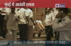 "An injured man lies on a hotel's baggage trolley in Mumbai, India in this image made from television, Wednesday, Nov. 26, 2008. Gunmen targeted luxury hotels, a popular tourist attraction and a crowded train station in at least seven attacks in India's financial capital Wednesday, wounding 25 people, police and witnesses said. A.N Roy police commissioner of Maharashtra state, of which Mumbai is the capital, said several people had been wounded in the attacks and police were battling the gunmen. ""The terrorists have used automatic weapons and in some places grenades have been lobbed,"" said Roy. Gunmen opened fire on two of the city's best known Luxury hotels, the Taj Mahal and the Oberoi. They also attacked the crowded Chhatrapati Shivaji Terminus station in southern Mumbai and Leopold's restaurant, a Mumbai landmark. It was not immediately clear what the motive was for the attacks.  (AP Photo/STAR NEWS)  **  INDIA OUT  TV OUT  **"