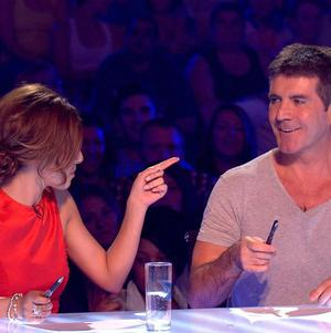 Sparks fly between X Factor judges Cheryl Cole and Simon Cowell when he brands her a 'brat' in the new series