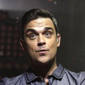Robbie Williams is to be reunited with Take That for the Haiti charity single