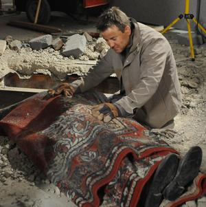 A scene from Coronation Street which sees John Stape (Graeme Hawley) uncover the body of Colin Fishwick